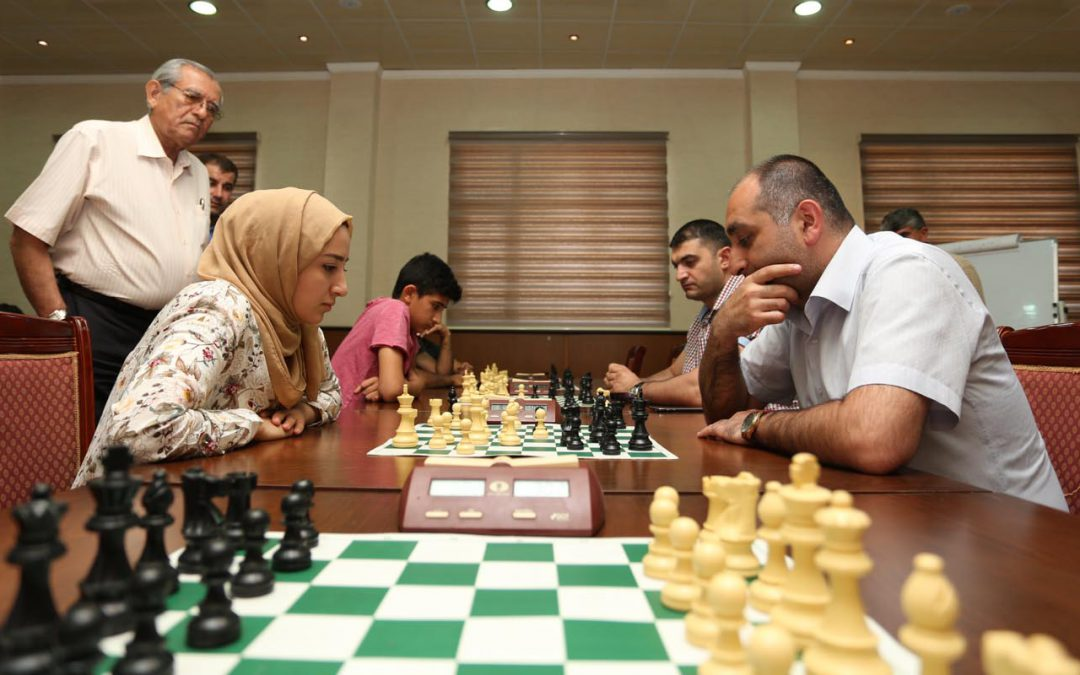 Azerbaijani chess players make moves to help Iraqi refugees