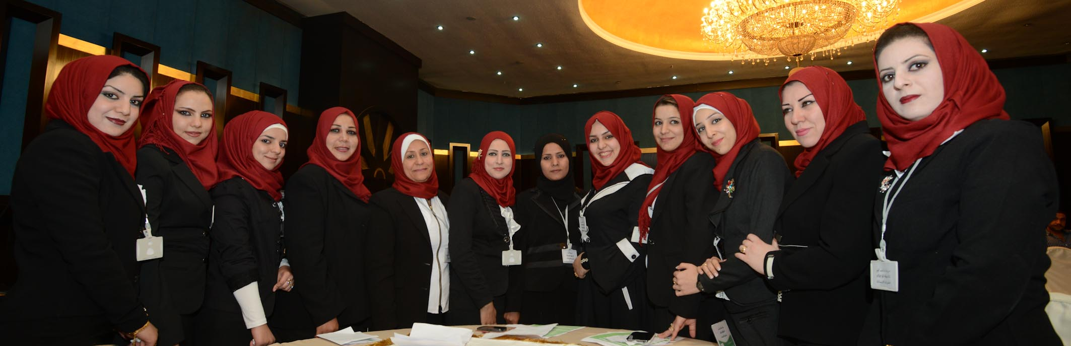 A Group Of Smartly-dressed Women Health Volunteers At An Annual AMAR Conference In Baghdad