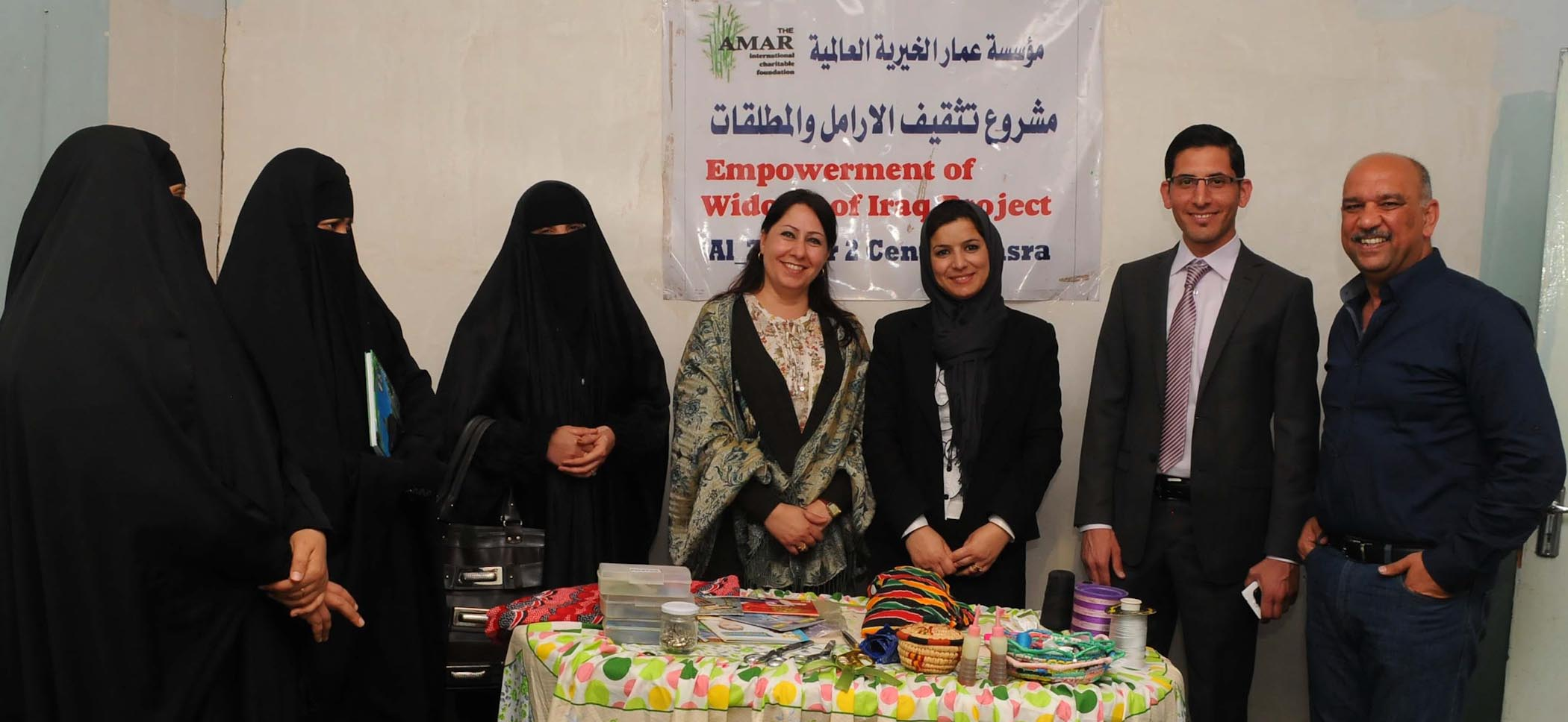 Women Involved With The Empowerment Of Widows' Programme Stand Alongside AMAR's Regional Manager, Dr Ali Muthanna (far Right) And Saif Tariq Of The Project Sponsors, Weir Group
