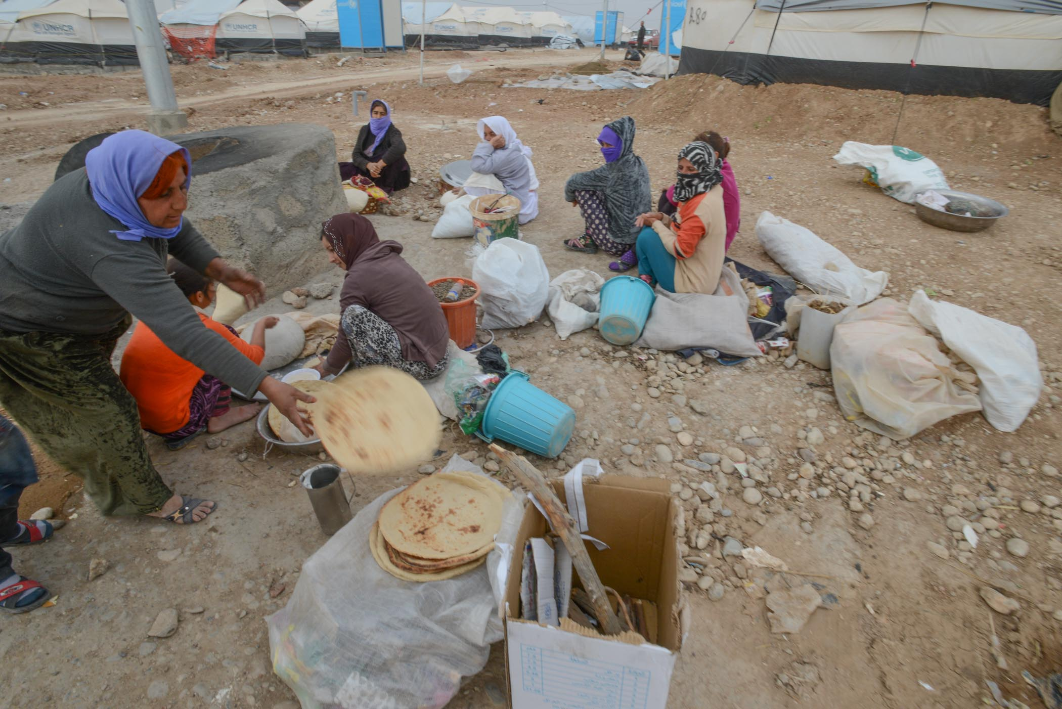 A Group Of Yazidi Women Baking Bread In The Khanke IDP Camp Near Dohuk