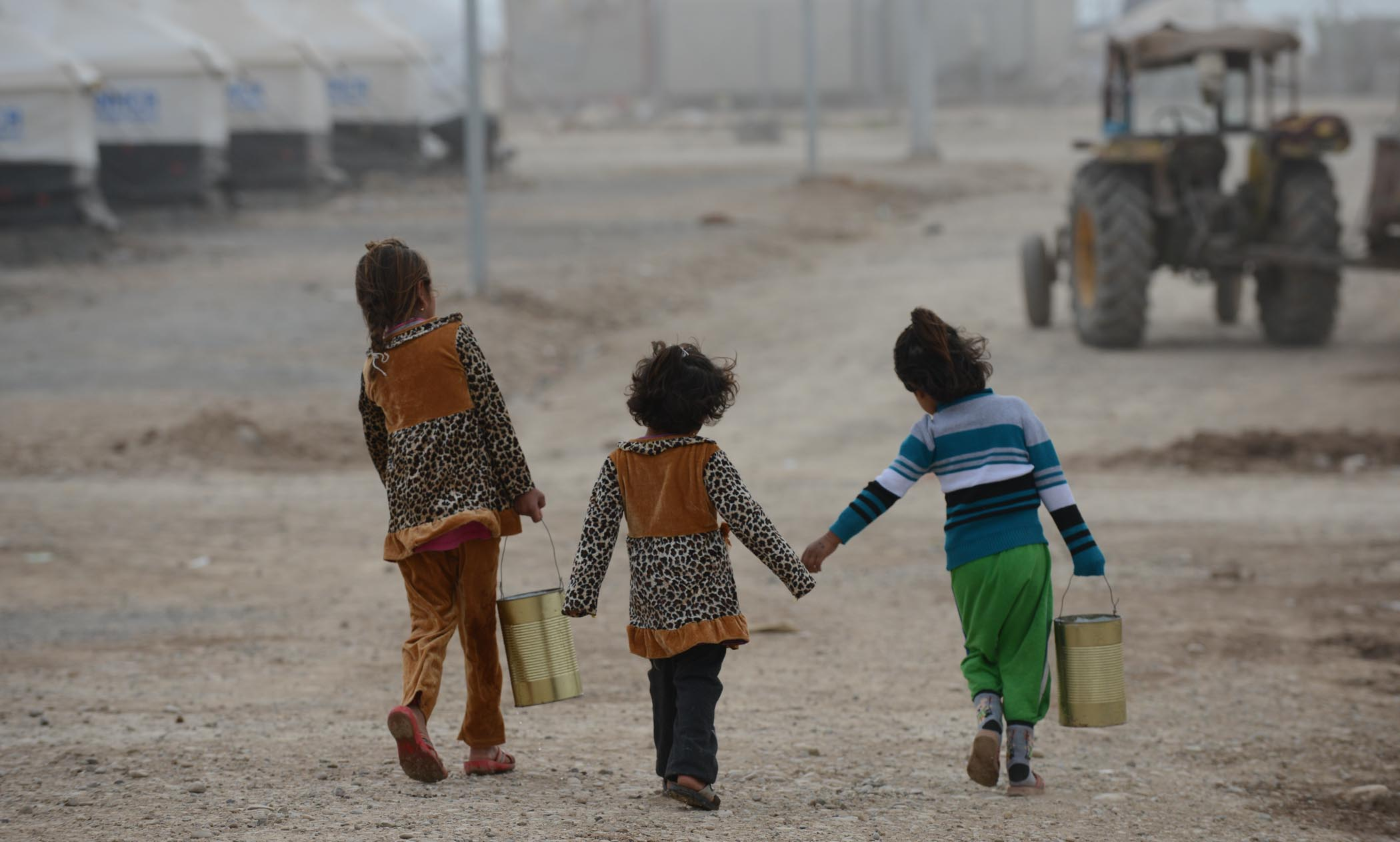 Three Young Girls Carrying Drinking Water Back To Their Tent In Khanke Camp, Dohuk