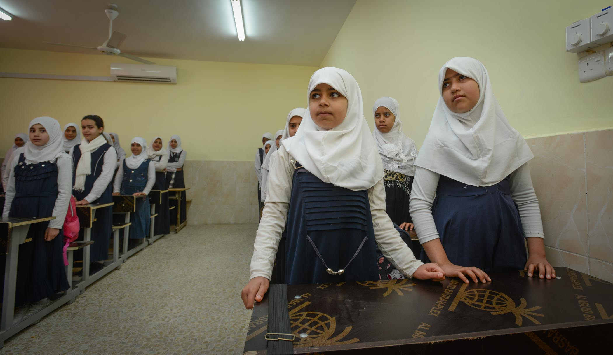 Schoolgirls Stand To Attention For Their Teacher