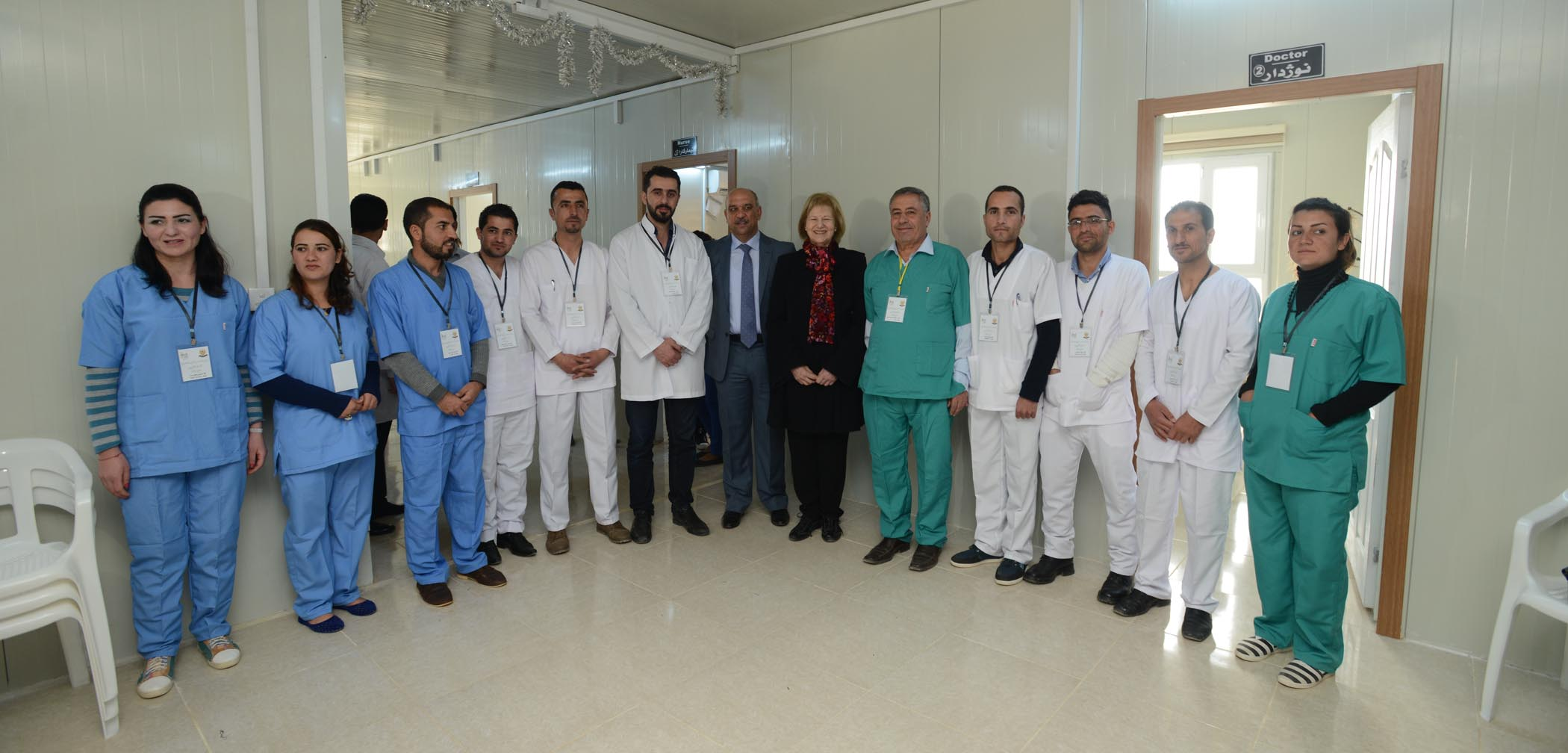 AMAR Chairman, Baroness Nicholson And Regional Director, Dr Ali Muthanna, Stand With The Clinical Team Working At The New Health Centre In Khanke.  The Majority Of Themselves Refugees Living In The Camp