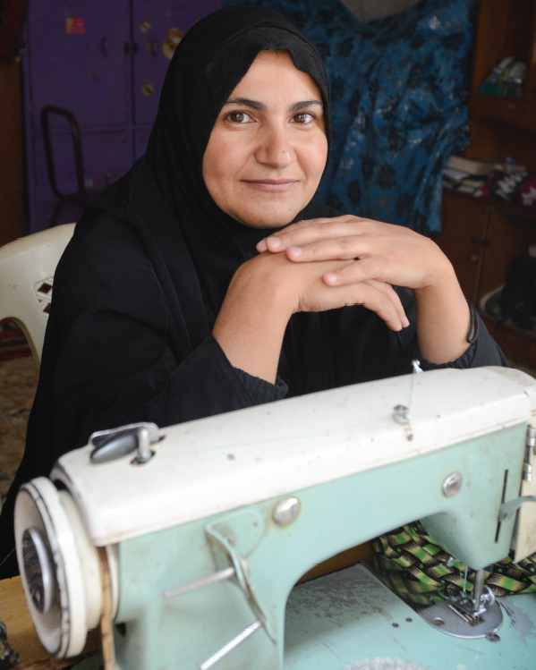 A Woman At Her Sewing Machine In An AMAR Training Session