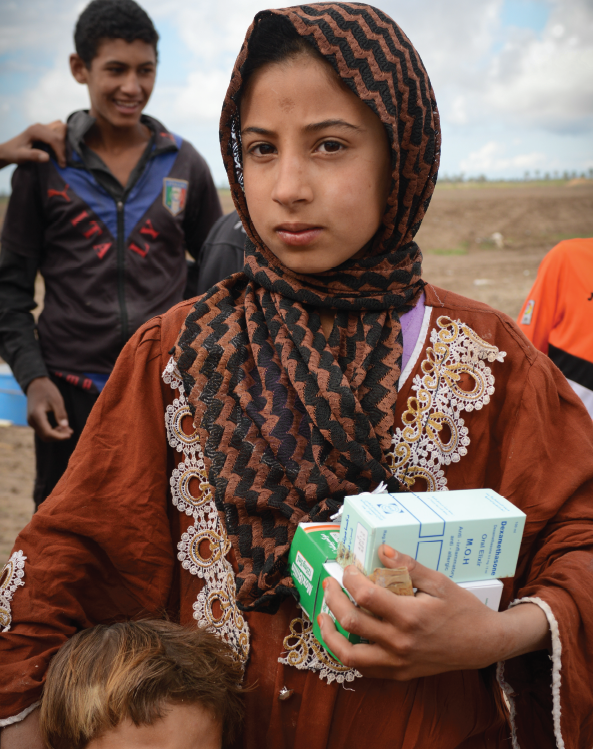 A Girl Carrying Medical Supplies Back To Camp