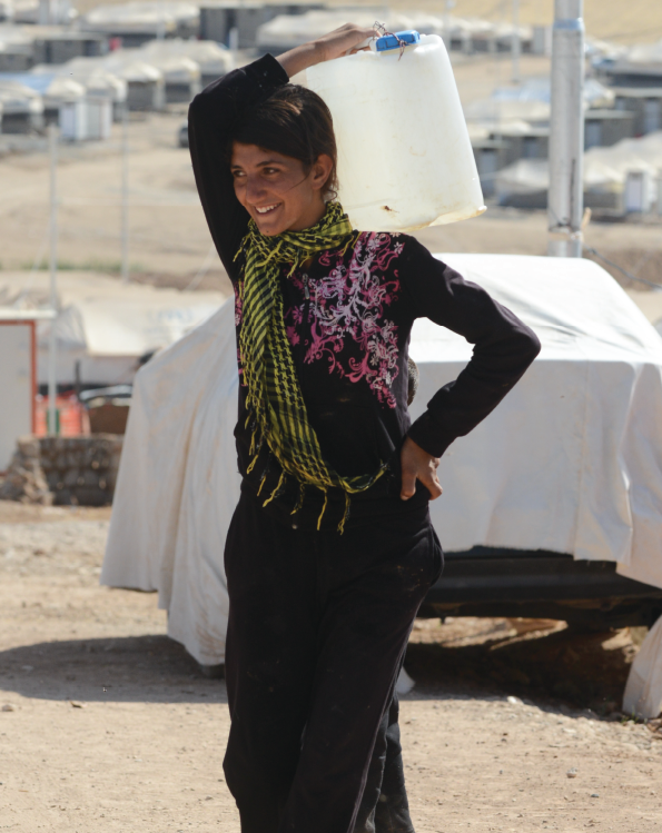 A Girl Carrying Water In An IDP Camp