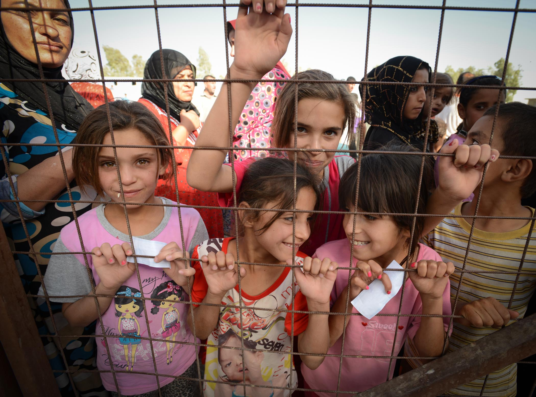 Excited Refugee Children Wait For A Food Delivery In The Baharka Camp In Erbil