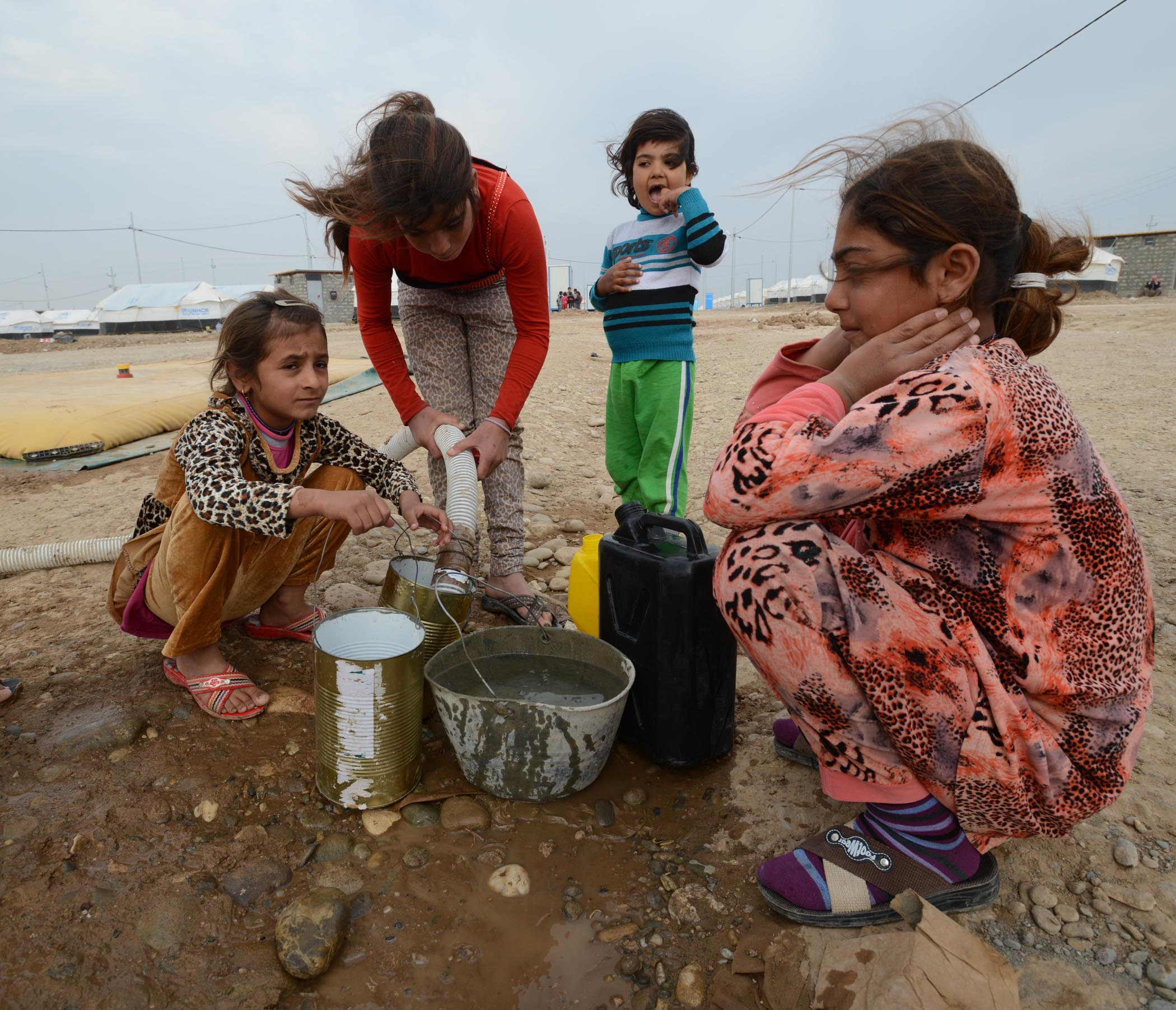 Yazidi Children Collecting Water In Khanke Camp