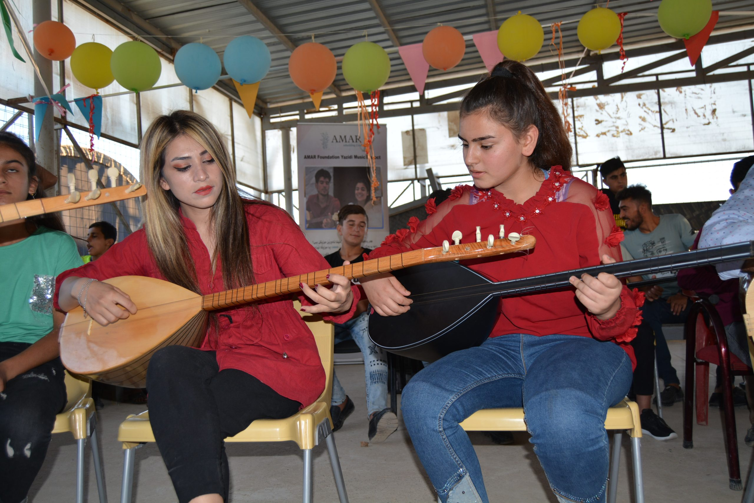 yazidi girl duo play tambours